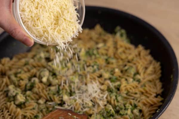 Adding grated parmesan to pasta
