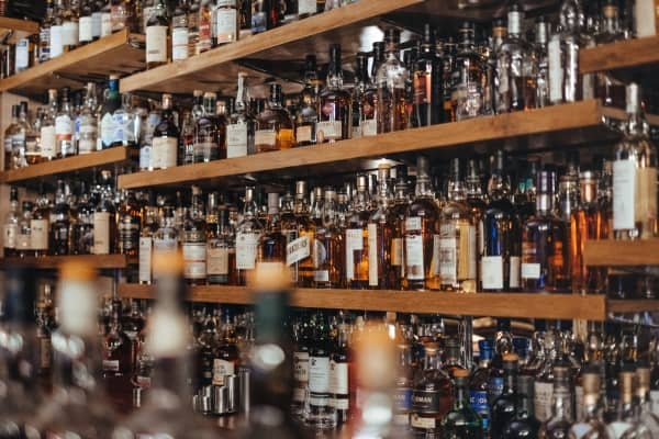Alcohol bottles lot on shelves