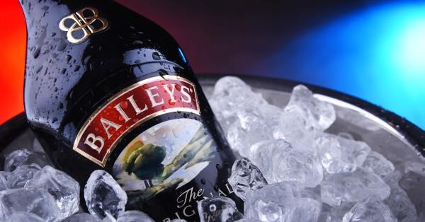 Bottle of Baileys Irish Cream in bucket with crushed ice