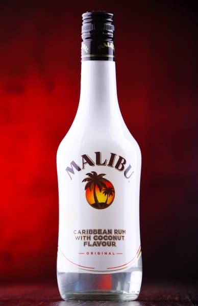 Bottle of Malibum rum on red background