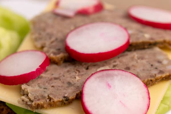 Bread and butter topped with radishes