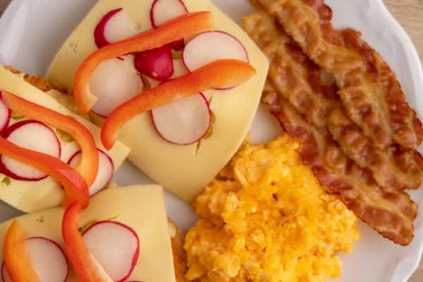 Bread, Gouda cheese, bacon, and scrambled eggs