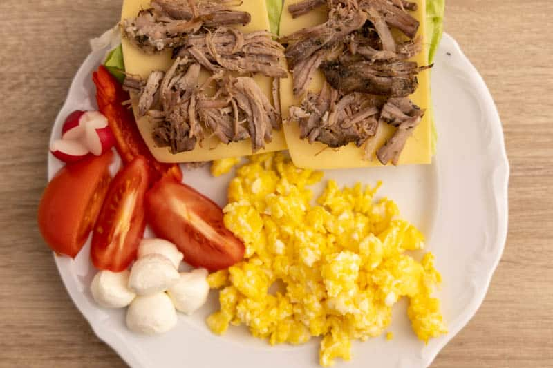 Breakfast with scrambled eggs and mozzarella