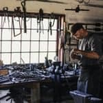 Busy craftsman in a toolshed