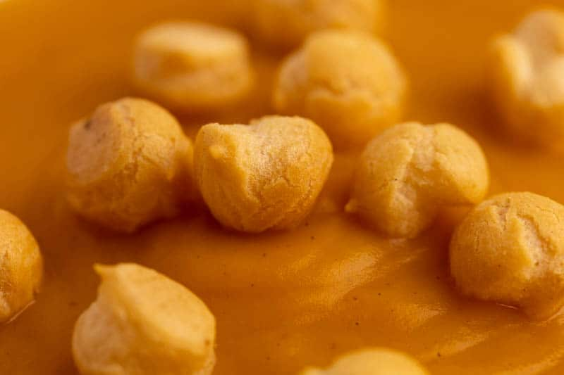 Butternut squash soup topped with soup pearls