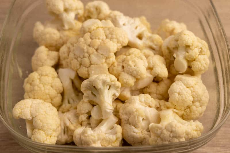 Cauliflower florets tossed with olive oil