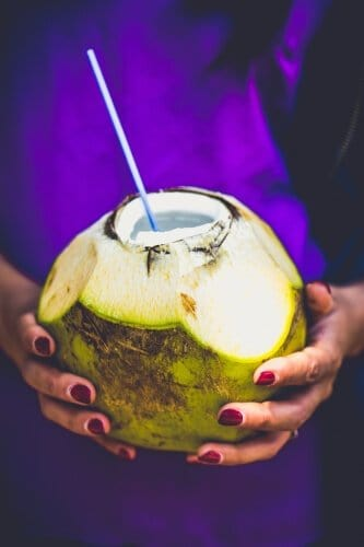 Coconut water with a straw