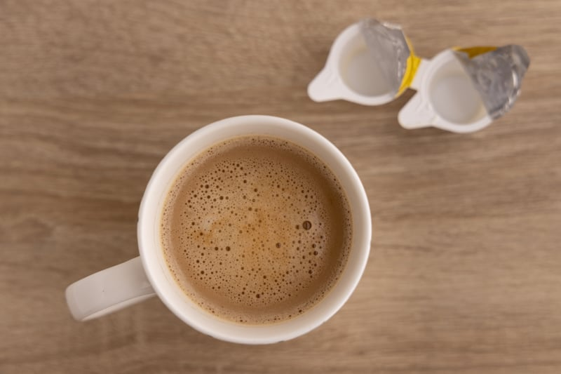 Coffee whitened with tiny creamers