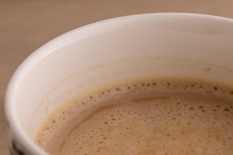 Coffee with creamer closeup
