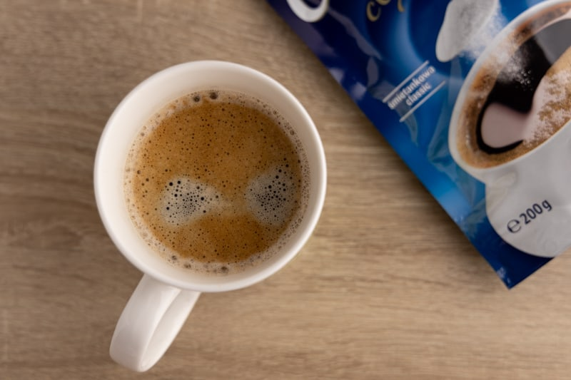 Cup of coffee and powdered creamer