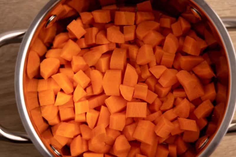 Cut up carrots in a pot