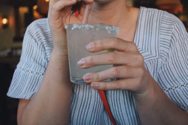 Woman drinking glass of tequila