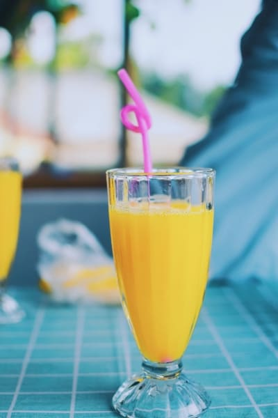 Glass of orange juice and a straw