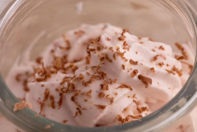 Ground chocolate on strawberry whipped cream