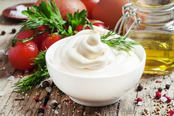 Homemade mayonnaise in a white bowl