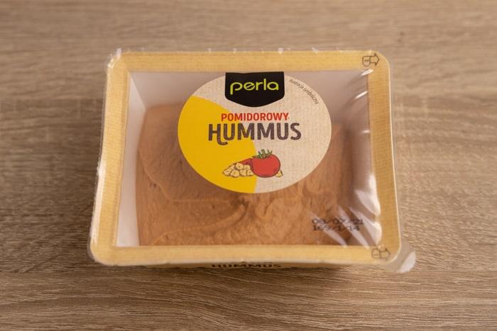 Tomato-flavored hummus contianer