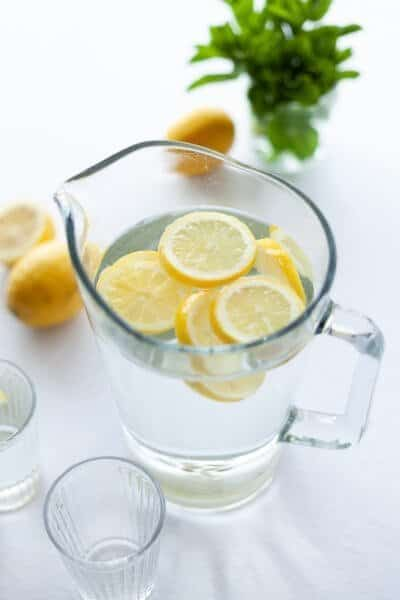 Lemon water in a glass pitcher