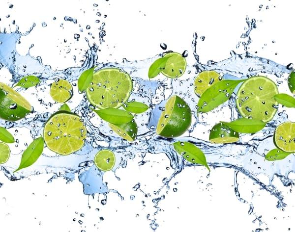 Limes in water splash