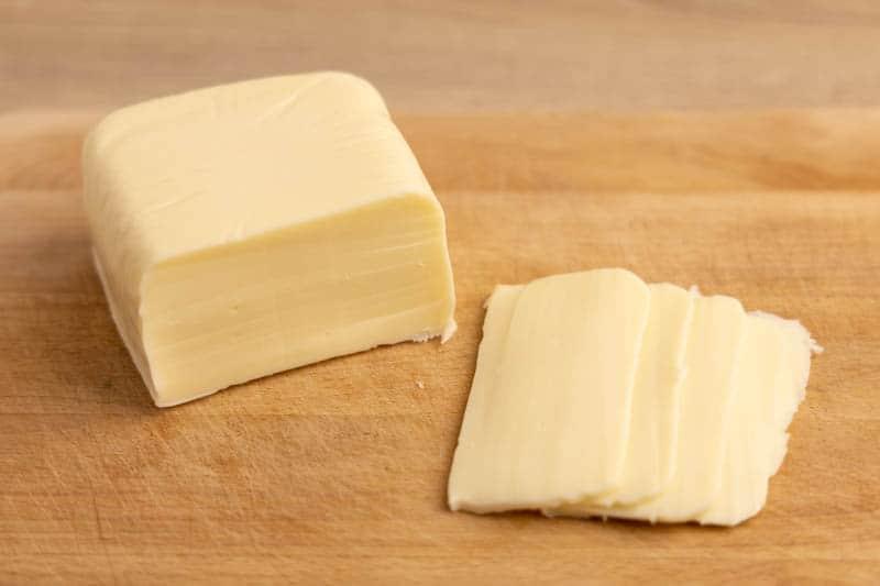 Mozzarella block on a cutting board