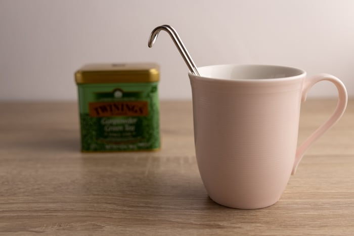 Mug, tea container, and an infuser