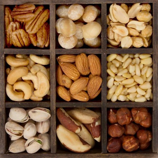 Nine varieties of nuts almond, cashew, brazil, hazelnut, peanut, pecan, pine, pistachio, macadamia