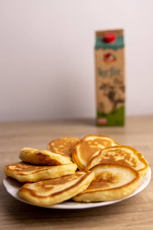 Pancakes and kefir in background