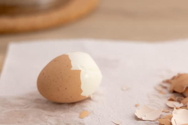 Peeling a hard boiled egg