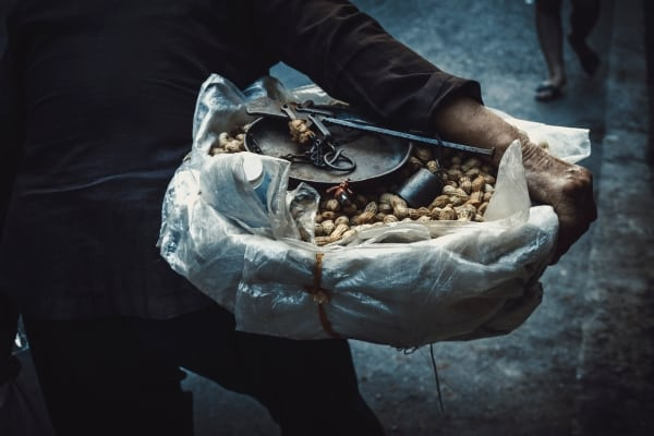 Person holding a big bowl of peanuts