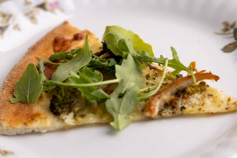Pizza topped with greens