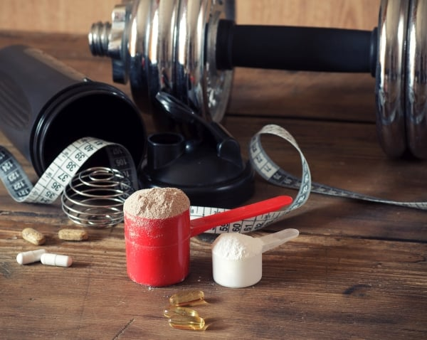 Protein scoops and some gym equipment