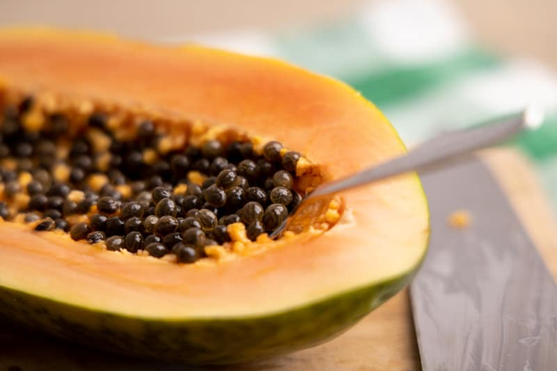 Removing seeds from a papaya