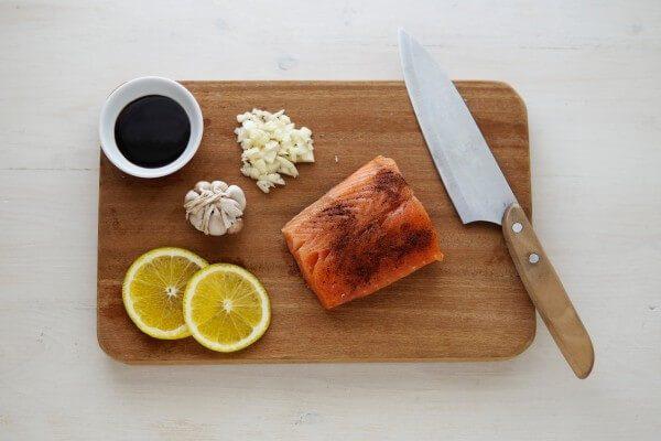 Salmon and seasonings on a cutting board