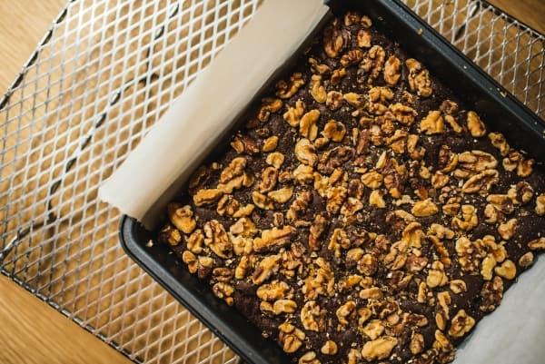 Shelled walnuts on a baking pan