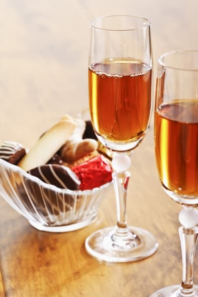 Sherry glasses and pralines in a bowl