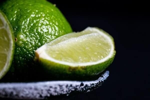 Sliced lime on grey bowl