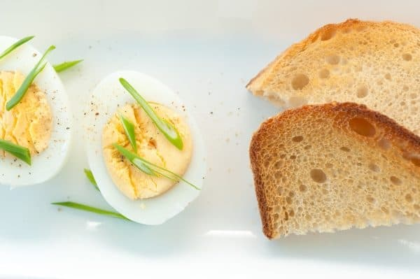 Sliced boiled eggs and bread