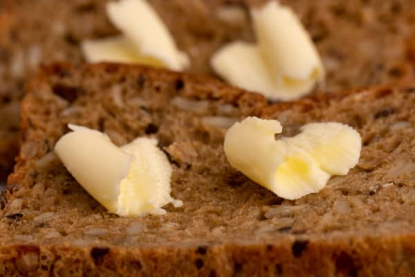 Slivers of butter on bread