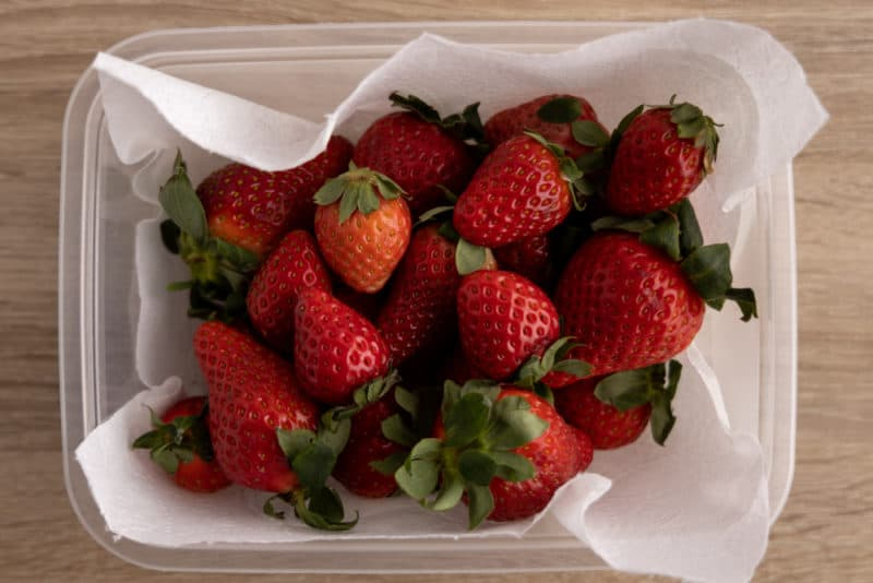 Strawberries in a plastic container