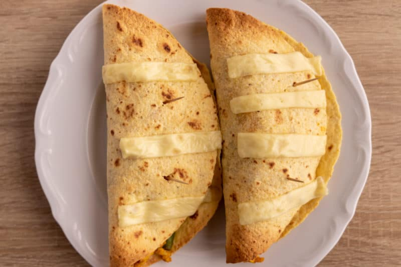 Tortillas topped with hard cheese