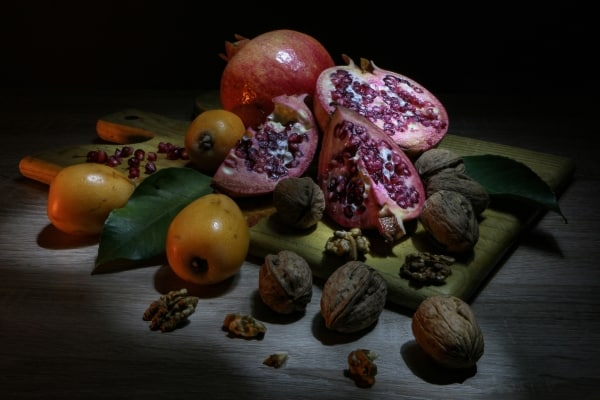 Walnuts and fruits on a cutting board