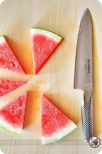 Sliced watermelon and a knife