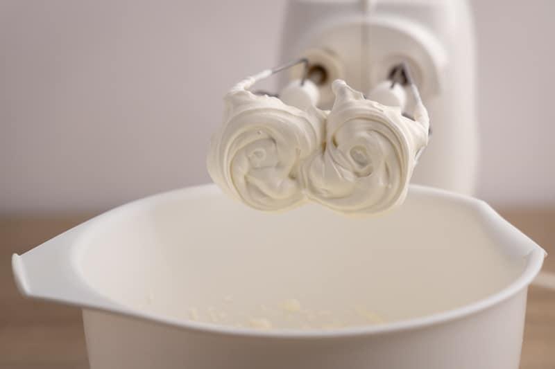Whipped cream on whisks